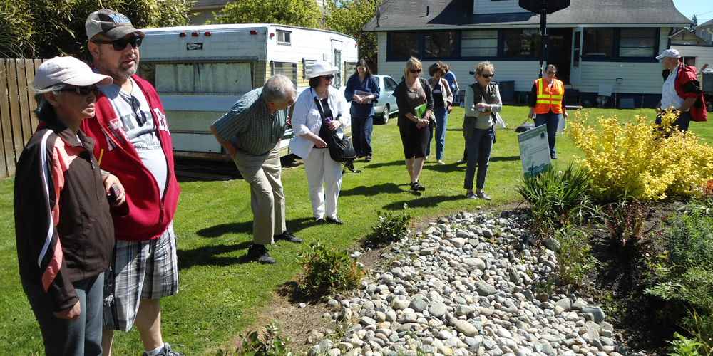 Photo of Natural Yard Care Workshop Participants learning about a rain garden