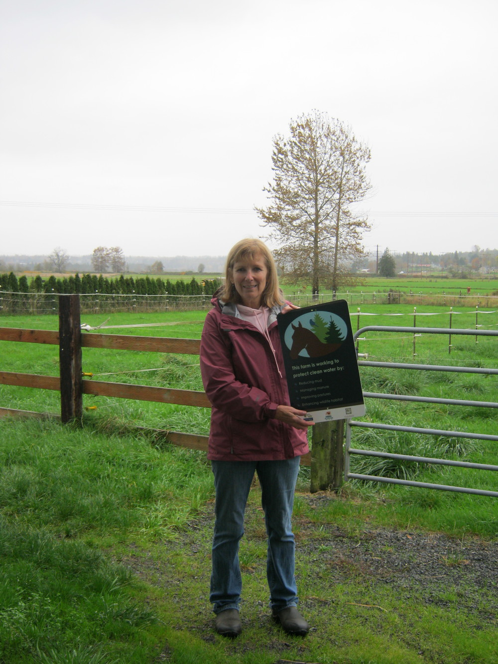 Picture of Julie with her Sound Horsekeeping Sign