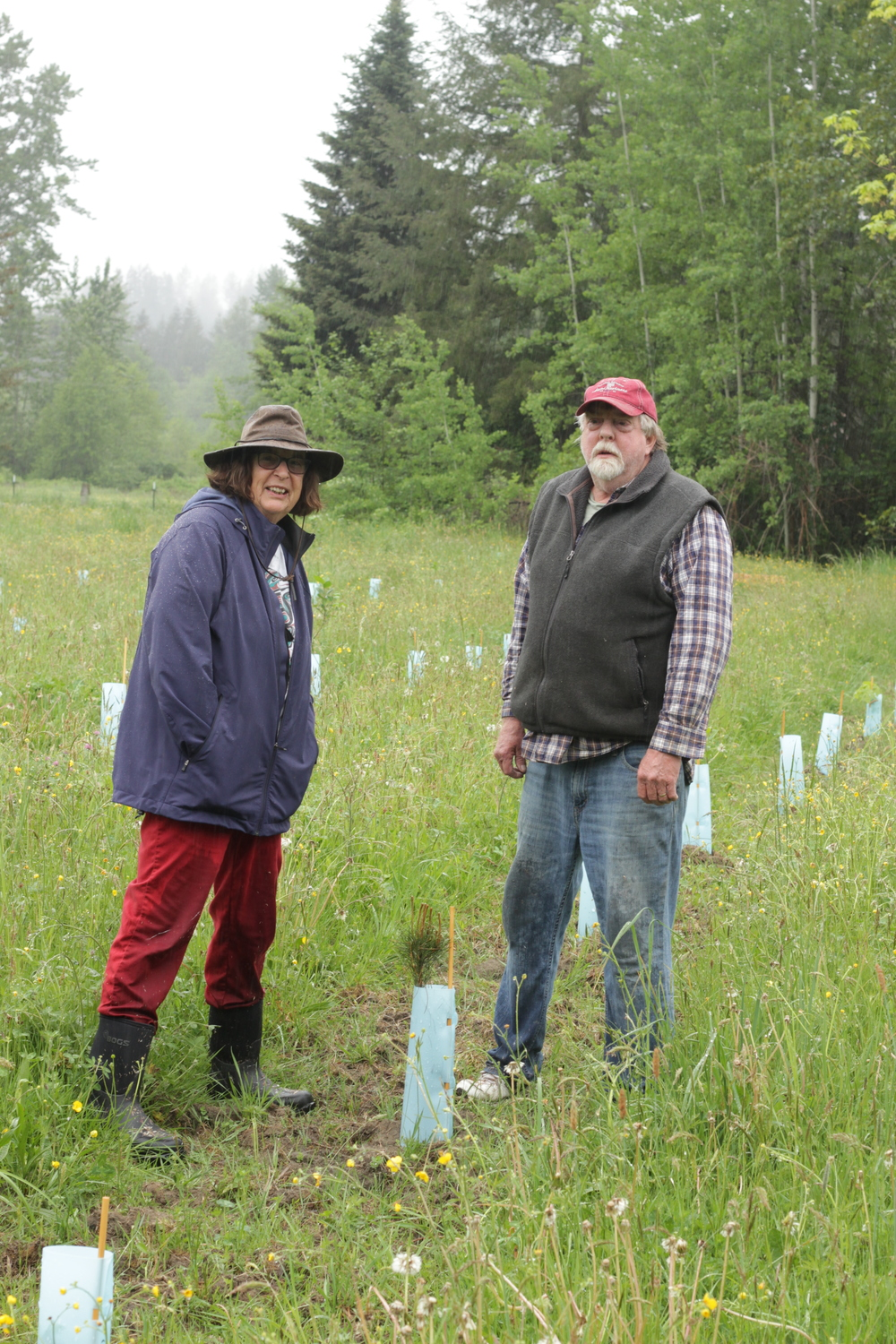 Photo of Sarah Arney and her brother, Bob Arney near their restoration site.
