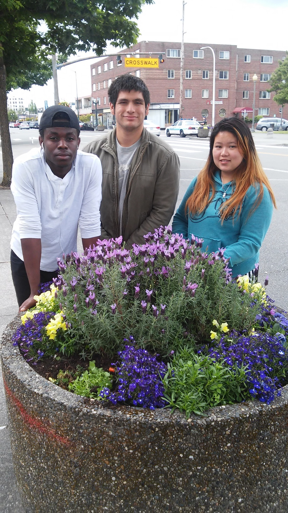 Students proudly stand by their school beautification project. Intermixed with ornamental plants are native succulents and ground covers donated through the Schools Plant the Future donation program. The ornamental plants were paid for through other funding.