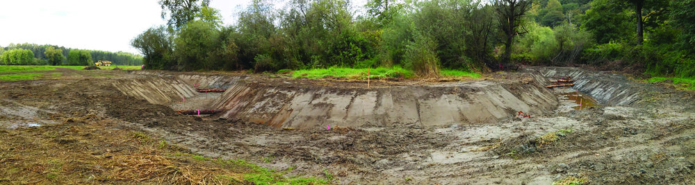 A panorama of the two channels with log placement. The banks will be seeded this fall, and native plants will go in this winter.