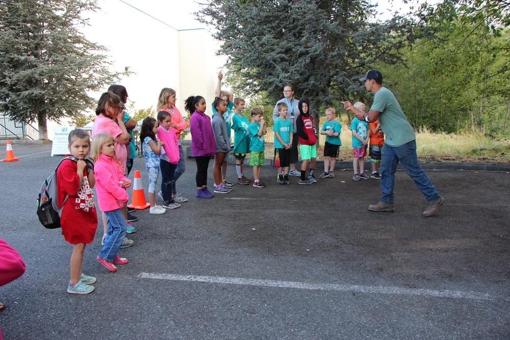 Cameron Coronado (SCD) gets the young YMCA volunteers ready to plant.