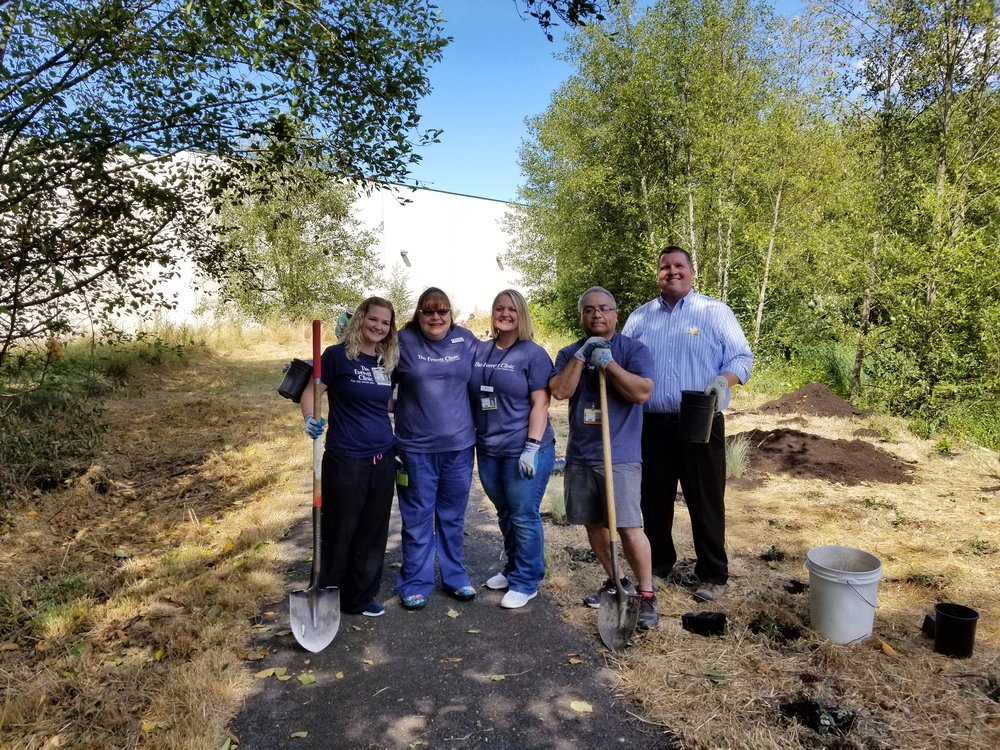 Staff from the Everett Clinic pose after planting their plants.