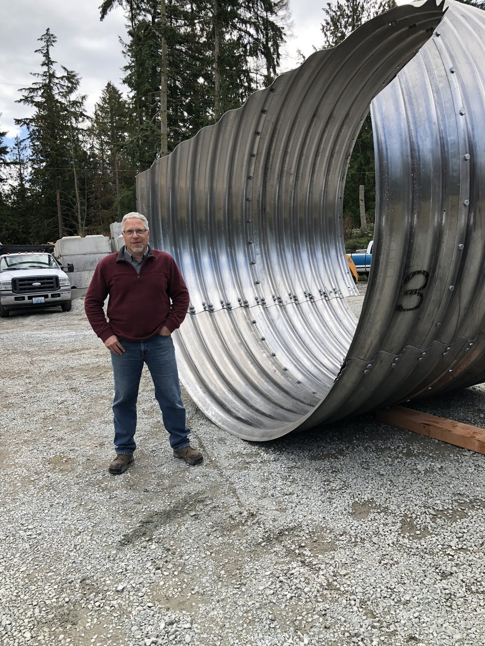 Remember the stacks of metal from the first update? Here they are at the beginning of assembly with SCD Engineer Ryan Bartelheimer present for scale.