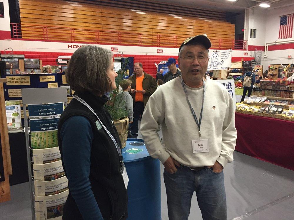 Kathryn speaking to a Skagit farmer