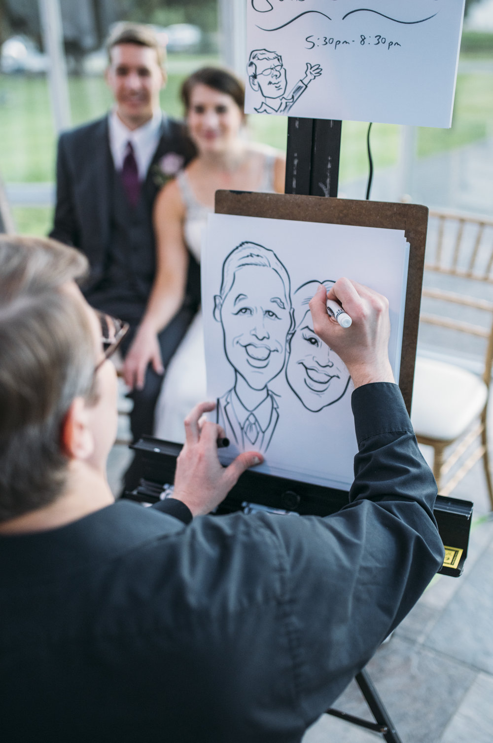 Instead of a Photo Booth, these two opted for a caricature artist! Such a fun idea.