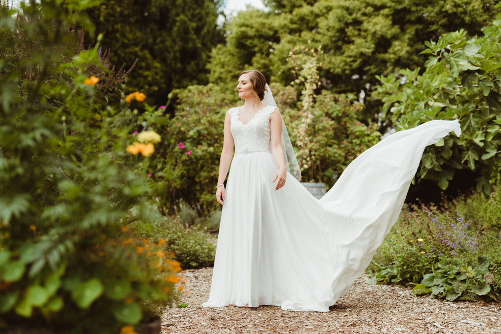 Bridal portrait with wind swept dress