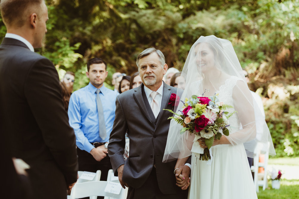 Father and daughter walking down the aisle