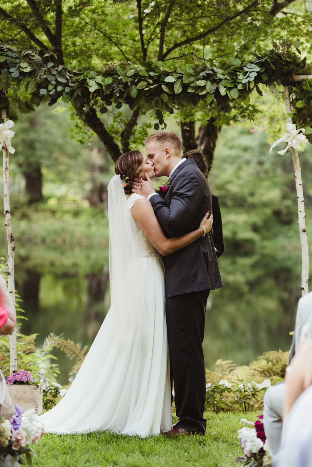 first kiss at a lakeside wedding