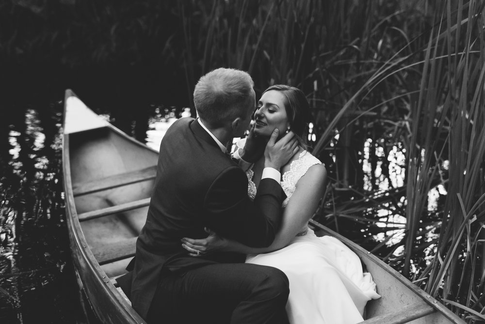 Bride and groom portrait in Canoe