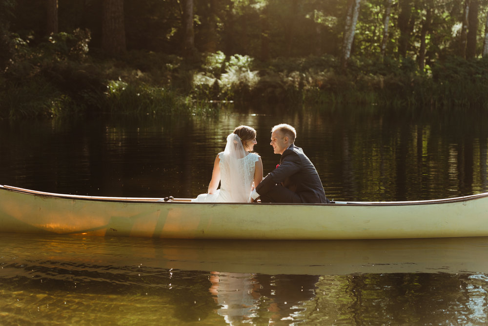 Bride and groom portrait in canoe on lake