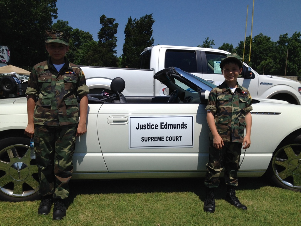 A few future service members watching the parade vehicle at the Thomasville Memorial Day Parade, 2014.