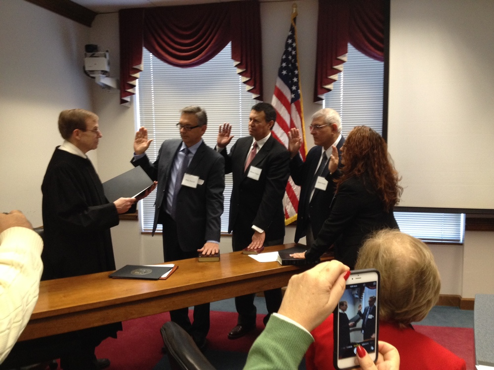 Administering oath to members of Governor's Hispanic Council, December 2014.