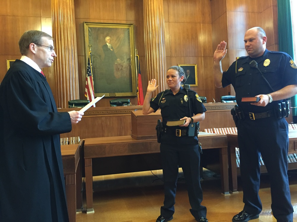 Justice Edmunds administers oath to two new members of Capitol Police, 13 October 2015.