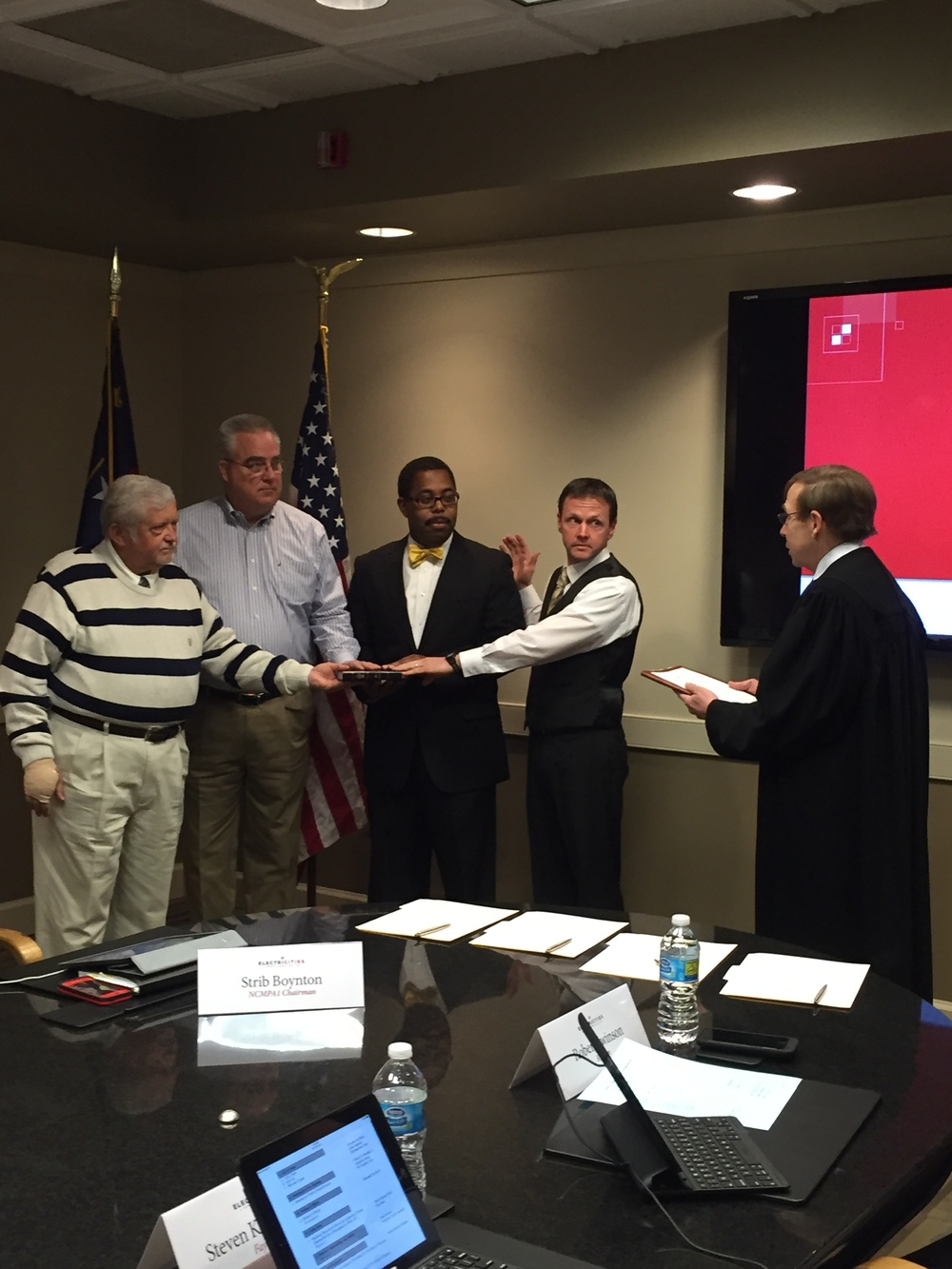 Swearing in new board members of Electricities of North Carolina, 29 January 2016.