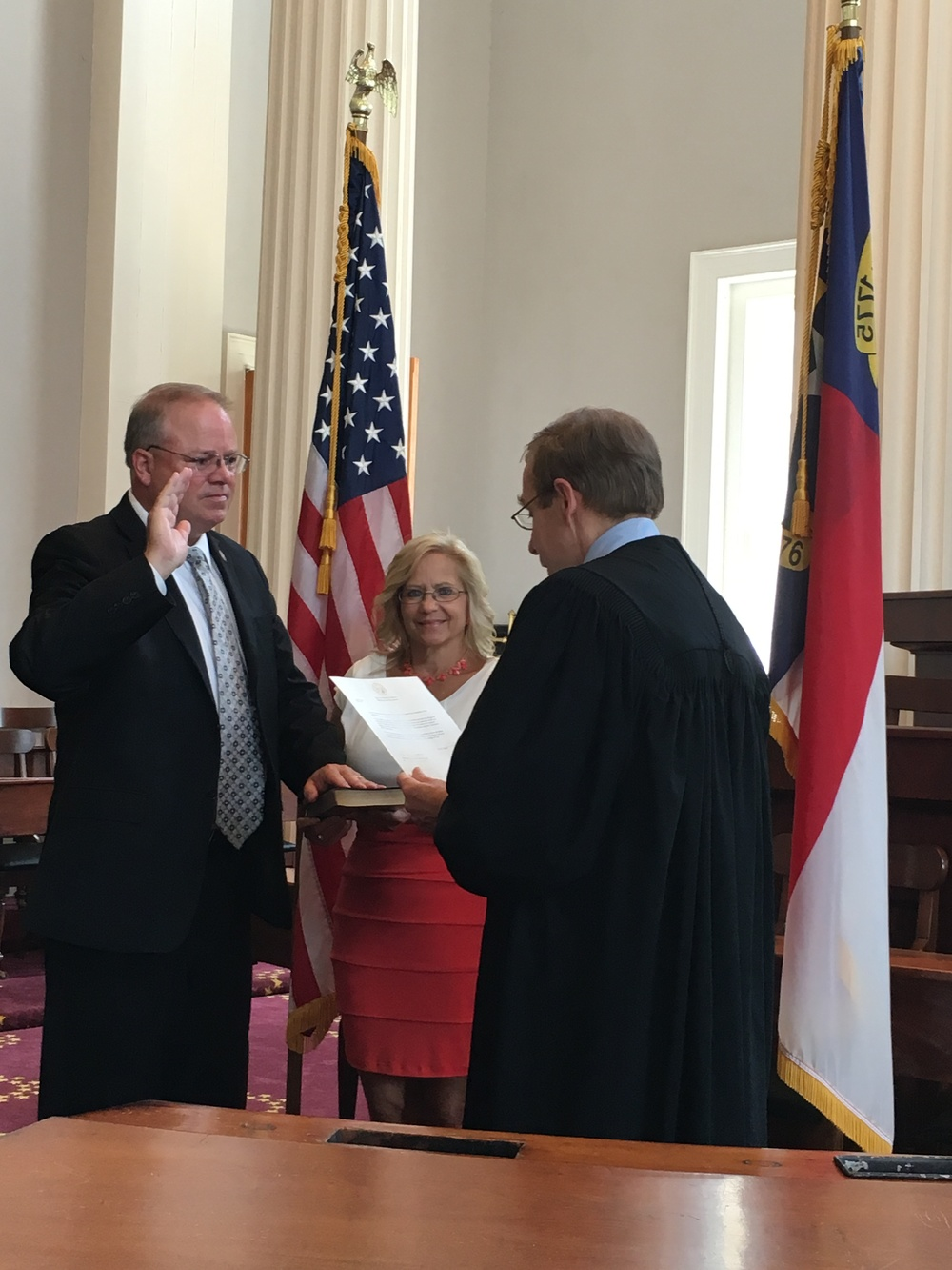 Administering the oath of office to Fred Steen, newest member of North Carolina's Board of Review, July 27, 2016.