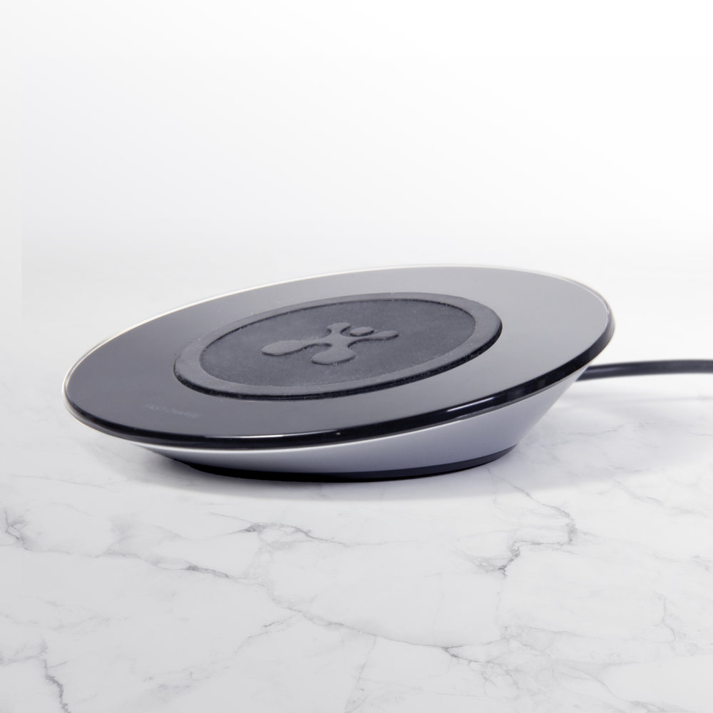 Qi Wireless charging pad - August 2017   Simple and intuitive - Our design for this wireless charging pad was centered around being easy to use and easy to understand. A clean, backlit surface glows when charging, combined with a rubberized pad to hold your device in place on a slightly inclined surface. Engineered to the highest level and visually clean, available online and in retail across the US.