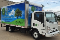 R2Sector's mobile e-cycling truck featuring the Isuzu Ecoboost engine with SCR technology, converting exhaust into natural elements