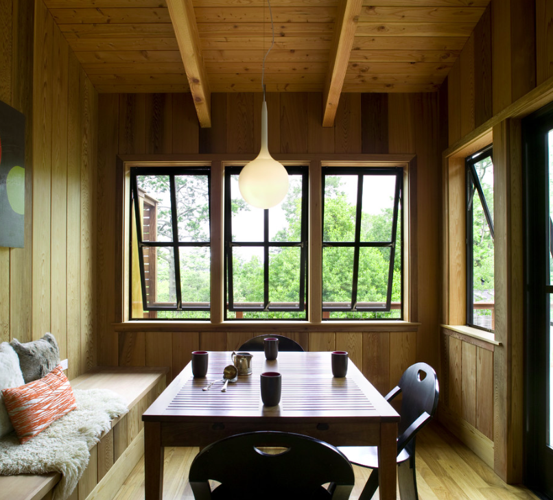 Photo by Gustave Carlson.This dining nook is fully clad in Western cedar, augmenting the home's connection to the outdoors.