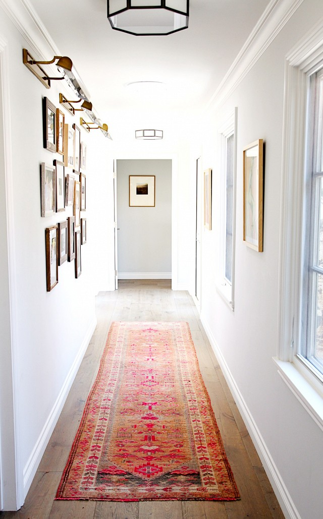 A beautiful and bold vintage runner adds color and pattern to create a dynamic hallway.  PHOTO: Sabra Lattos Photography