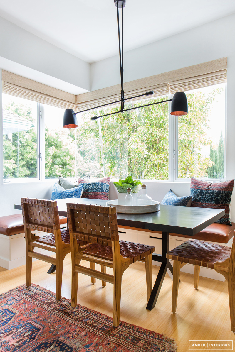 The very essence of California cool—black light fixture, leather chairs and a gorgeous vintage rug.  PHOTO: Tessa Neustadt for Amber Interiors