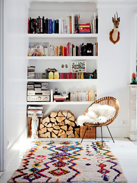 A recessed white bookshelf holds far more than just books. PHOTO: Milk Magazine