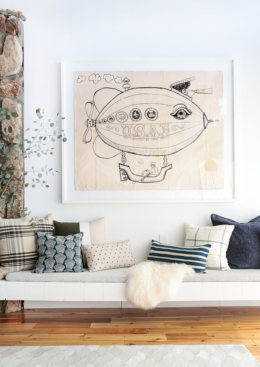 Quirky, oversized artwork paired with pretty pillows—always a win in our book.  PHOTO: Emily Henderson, www.stylebyemilyhenderson.com