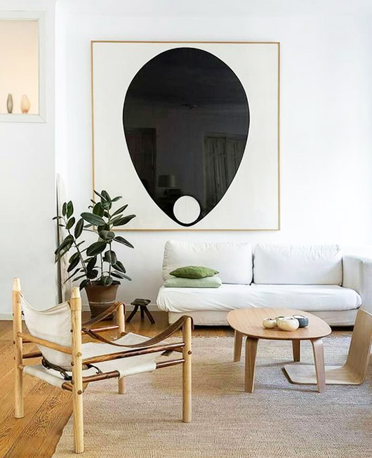 Graphic black and white artwork punctuates the bright, neutral space.  PHOTO: SF Girl by the Bay
