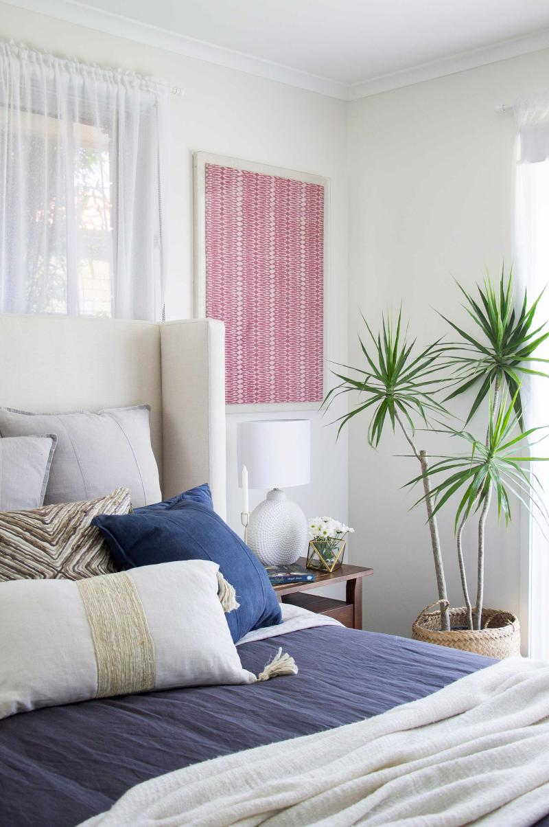 Layered throw pillows add color, texture and subtle pattern.  Photo: Inside/Out Australia