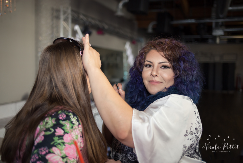 Janet Cruz applying makeup to a client at Fusion Nightclub in Fort Collins, Colorado