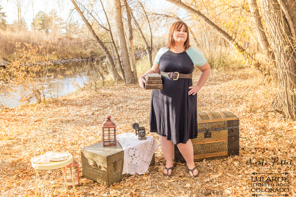 Woman holding books in Lularoe with Jennifer from Colorado clothing at the Poudre River Trail in Fort Collins, Colorado