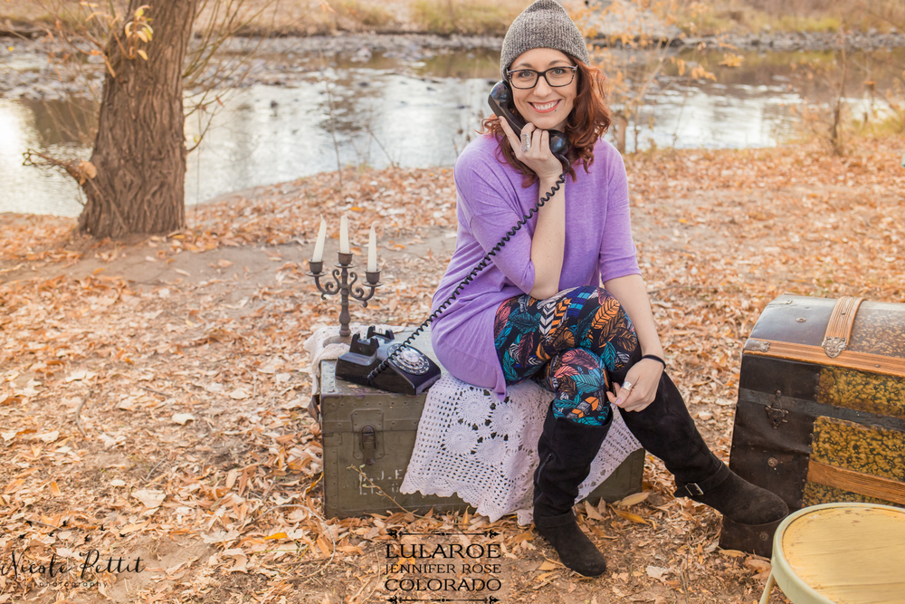 Woman modeling Lularoe with Jennifer from Colorado feather leggings on a rotary phone at Poudre River Trail in Fort Collins, Colorado