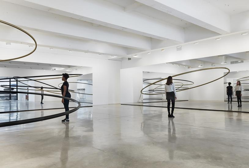 The railings complete their circles in the reflections of the mirror.  They repeat in an endless mirror effect.  (Photo: http://www.tanyabonakdargallery.com/exhibitions/olafur-eliasson_9/6