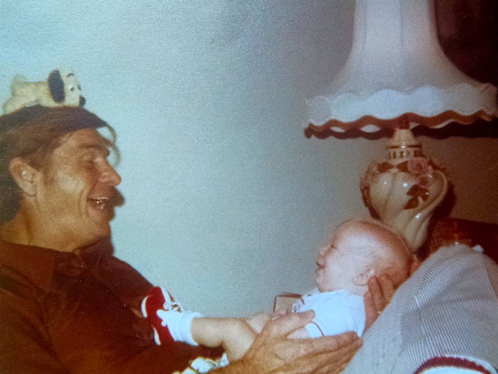 Bapa entertaining me with a routine at 4 months old