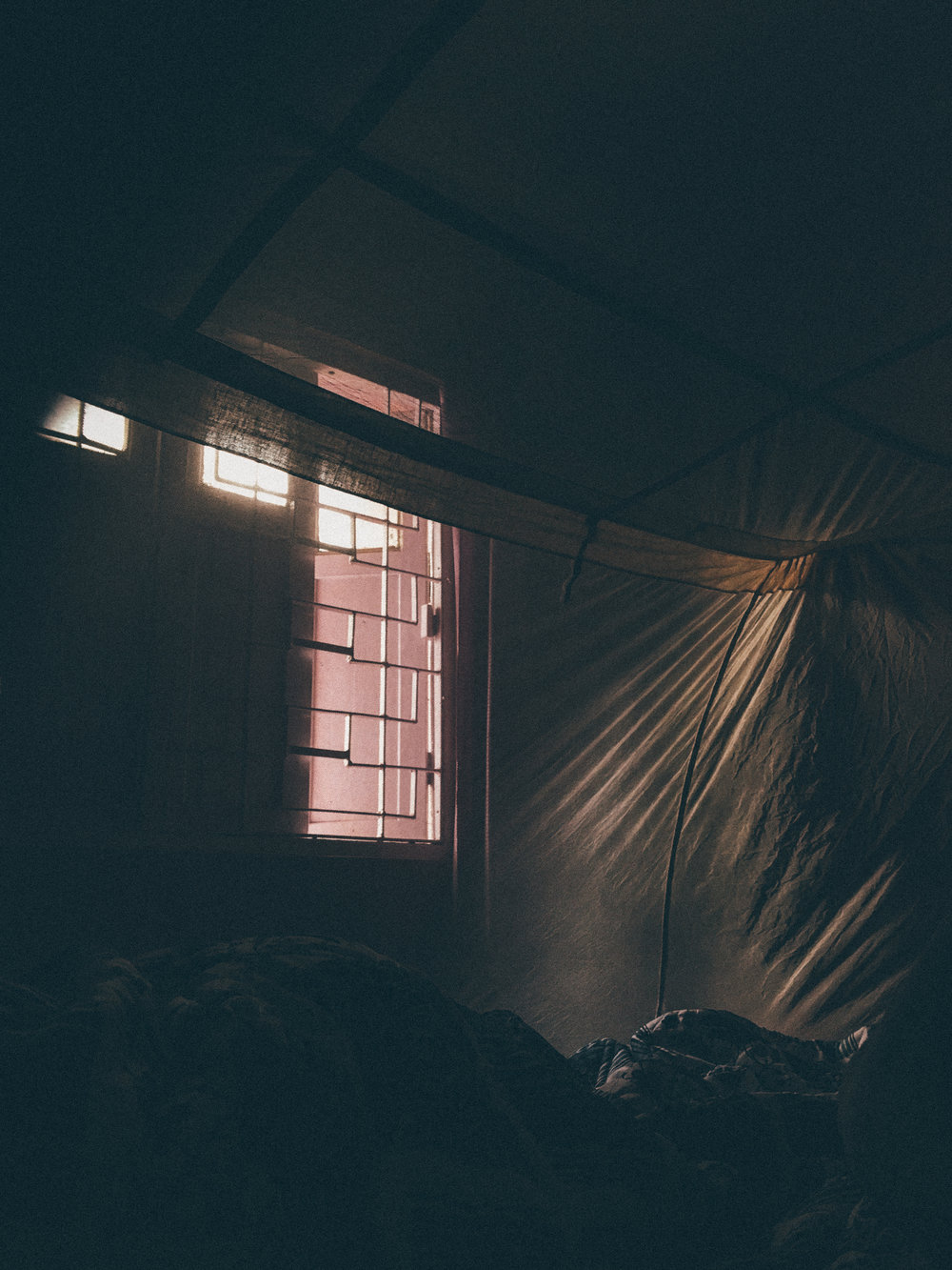 Sleepy mornings under the mosquito net.