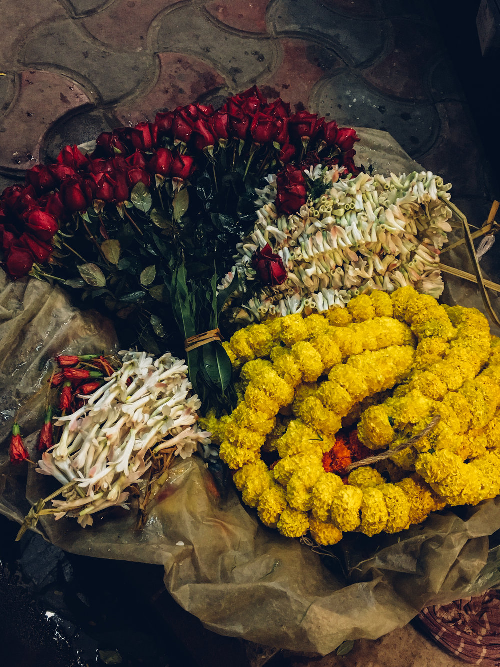 A flower seller's goods at Garihat Market.