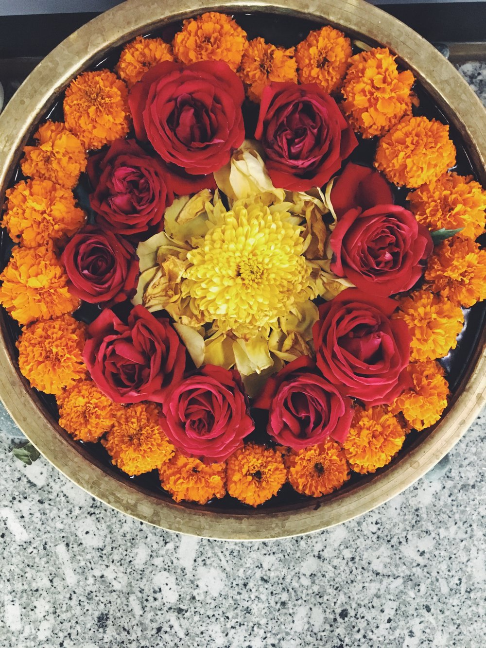 Beautiful flowers in a brass urn at the Kolkata airport.