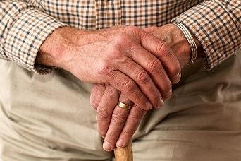 hands-walking-stick-elderly-old-person-min.jpg