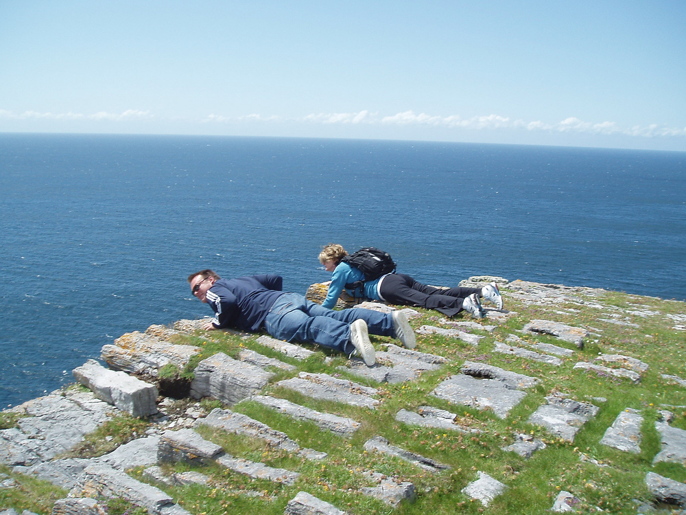 Looking over the edge at Dun Aengus Aran Islands Ireland