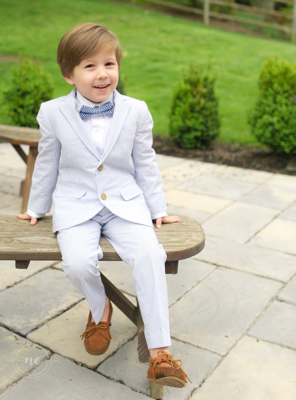 little boy in a suit and bowtie