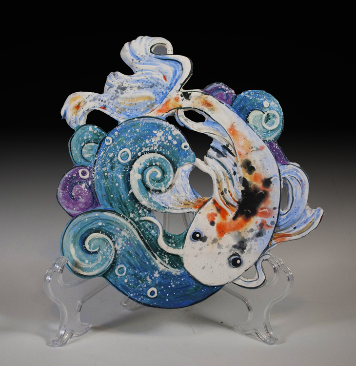 Stephanie Michaud - Booth 79 Using various types of clay, I sculpt each sculpture and tile, glaze, often w/ terra sigillata or acrylics and use wire, feathers, horsehair and beads in the completion of the piece.