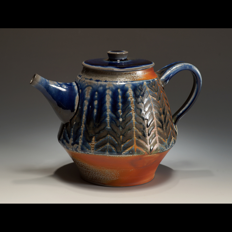 Carolina Niebres - Booth 47 Functional thrown or hand-built stoneware high temperature fired with a baking soda mixture added to kiln's ware chamber. Decorated with wax resist patterns and glaze or slips and underglaze lines.