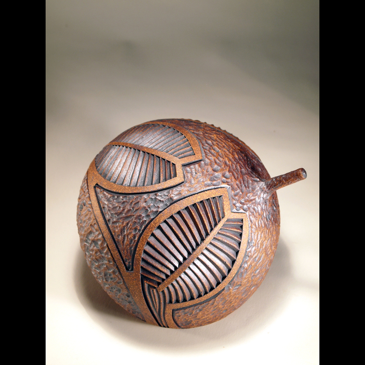 Richard and Elizabeth Robertson - Booth 20 I make singular stoneware forms that are turned on the wheel. I carve linear patterns into the clay that grow from and extend the form. Most patterns are based on things I find in nature.