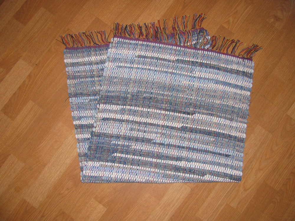 Cindy Brown - Booth 28 I weave rugs on a floor loom using 100% recycled fabrics (old clothing, blankets, etc.) I use only natural fabrics - cotton or wool. All material is pre-shrunk so the rugs are machine washable.