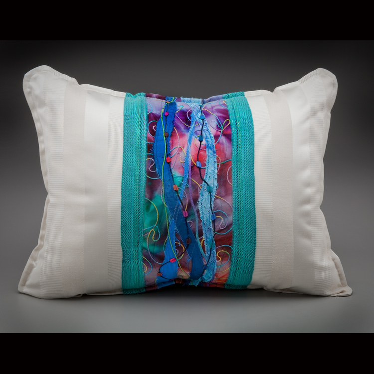 Barbara Geurink - Booth 43 I Handweave textiles for personal fashion and interiors. I also incorporate beading, quilting and various appliqués techniques to embellish my pillows and runners. I focus on color and experiment.