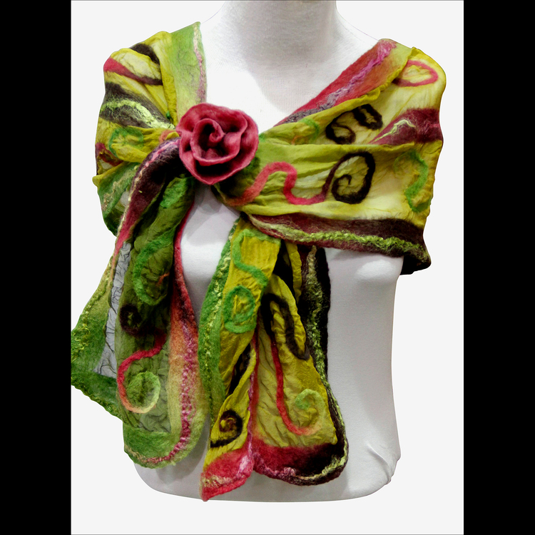 "Gayle Hallin - Booth 48 Nuno-felting is used with fine mesh silk fabric along with silk & wool roving to create scarves in varied designs with a sculpted effect. ""Button-flowers"" are hand stitched from felted strips."