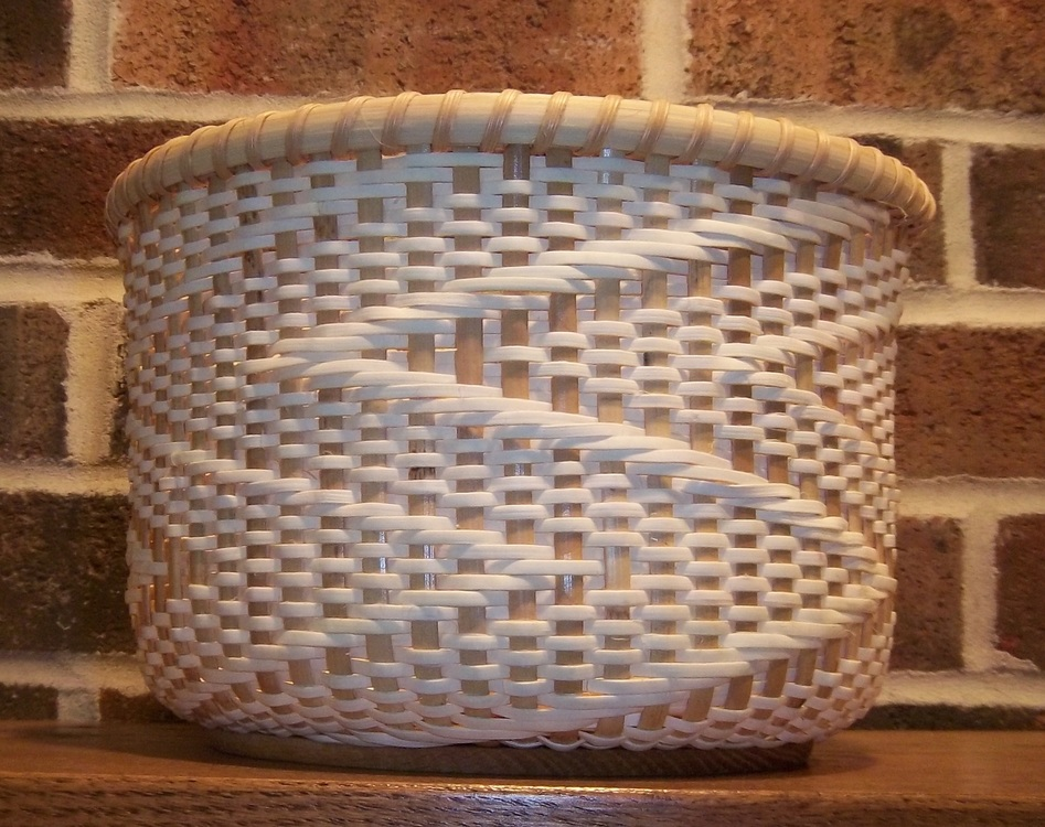 Sue Soenen - Booth 25 Weaving with rattan reed since 1992, I use techniques of twining, twill, lashing, and three rod wale to create designs of useful and decorative baskets.