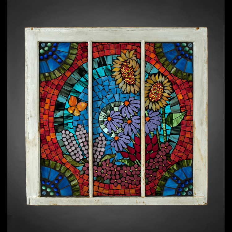 Robin Mueller - Booth 7 Glass on glass mosaic (quilting with glass). Frames/recycled windows, barn wood. Saucers, beads for dimension. Stained and fused glass. Original designs. Vibrant.