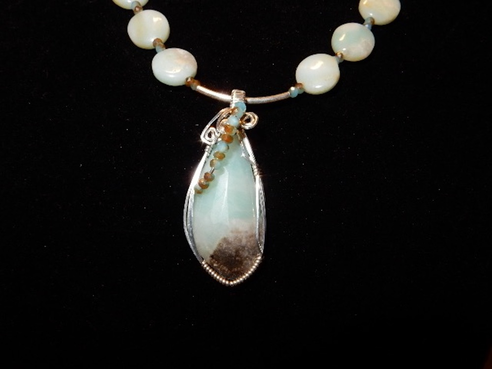 Marlene  Ilecki - Booth 89 I wire wrap natural stones with sterling silver or gold filled wire to create a pendant. I also make earrings, bracelets, and necklaces using natural stones and crystals