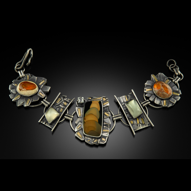 Nadine King - Booth 26 Sterling,18&22kt.gold,precious stones,rare jaspers.  Fused and etched metals. Reticulation, forming, patinas to highlight texture in metals. Stones are bezel,prong or tube set with some inlay.